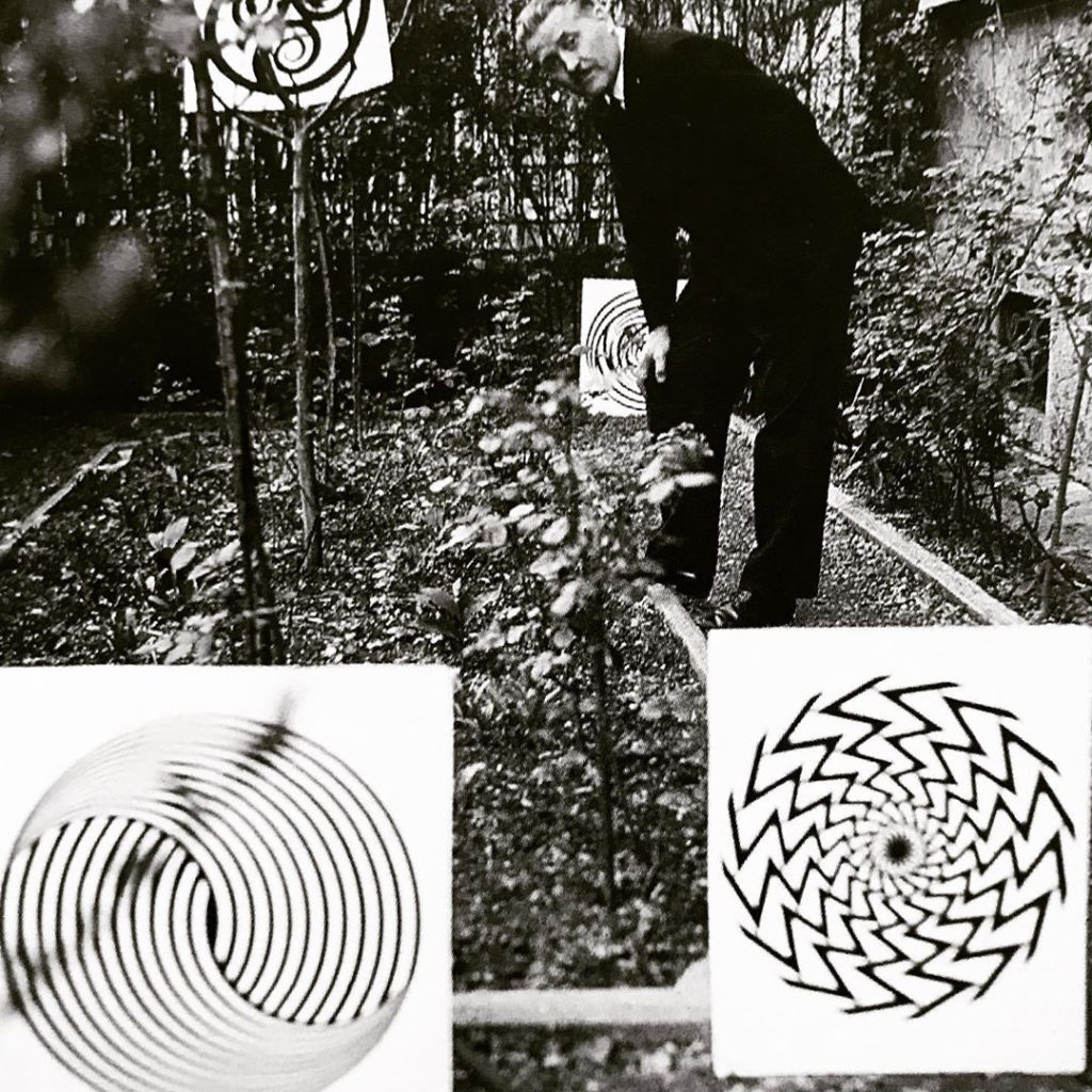 Franco Grignani playing in the garden of his studio in Milan, 1967
